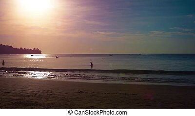 Tourists Bathing on a Tropical Beach at Sunset Video -...