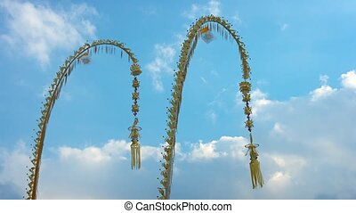 Pair of Hindu Penjors against a Blue Sky Video - Pair of...