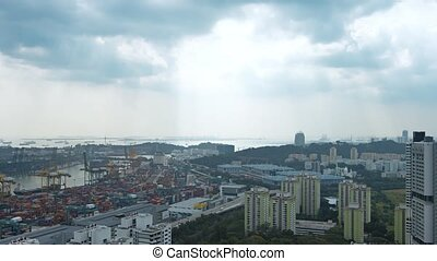 Singapores Cityscape and Container Yard against the Horizon...