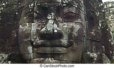 Face of Ancient Stone Sculpture at Bayon Temple in Cambodia....