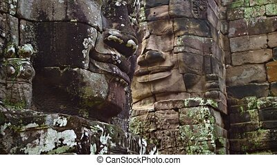 Ancient and Enormous Stone Faces at Bayon Temple in Cambodia...