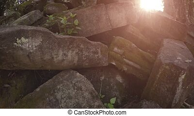 Heap of Ancient Stone Blocks at a Temple Ruin in Cambodia -...