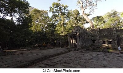 Tourists Visit Angkor Temple Ruins in Cambodia - Tourists...