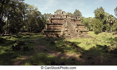 Phimeanakas Temple Ruin - Loose stones lie scattered from...
