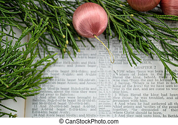 Christmas story and greenery with pink ornaments - The...