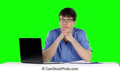 Young worried doctor holding his head Green screen - Young...