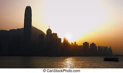 Hong Kongs Skyline and Ferry Boat at Sunset - Ferry boat...