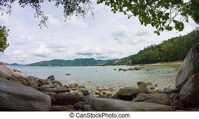 Peaceful Lagoon along a Rocky Beach on a Cloudy Day