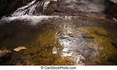 "Water Pouring over Rocks - ""Water pours over slick rocks of..."