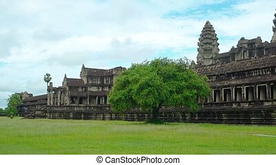 Long Face of Angkor Wat, Fronting a - Tourists stroll along...