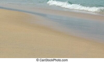 Sea surf on clean sandy beach. - Sea surf on a clean sandy...