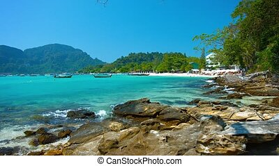 Seacoast with stones and trees. Thailand. Video FullHD