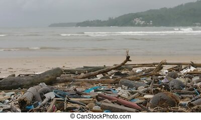 """Polution in form of garbage and assorted debris, washed up..."