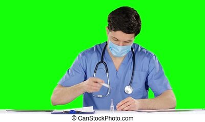 Doctor is preparing to make an injection Green screen -...