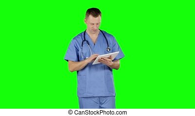 Doctor uses a tablet and shows thumb down. Green screen -...