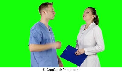 Controversy of two doctors. Green screen - Female doctor...
