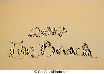 2017 written in sand, on tropical beach