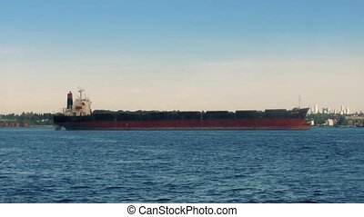 Moving Past Large Freighter Ship - Moving shot of long...