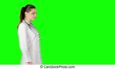Female doctor smiling to camera. Green screen
