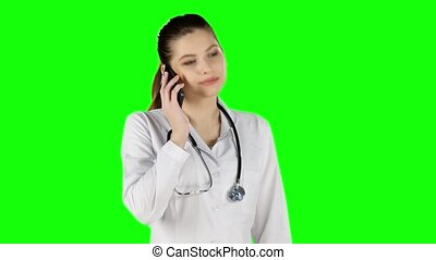 Pretty doctor talking on the phone Green screen - Pretty...
