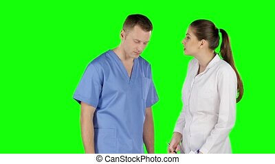 Dispute of two young doctors. Green screen - Two young...