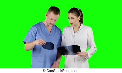 Two doctors with x-ray prints. Green screen