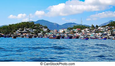 several Fishing boats with red flags in marina at Nha Trang,...