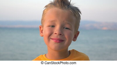 Little blond child on sea background - Close-up shot of a...