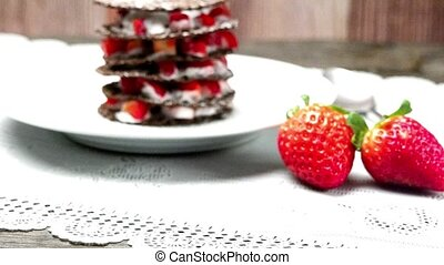Strawberries desert with cream and wafer served on plate...