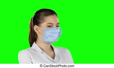 Doctor with injection. Green screen. Closeup