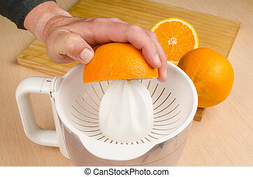 Juicer - Small electric juicer on a wooden kitchen table