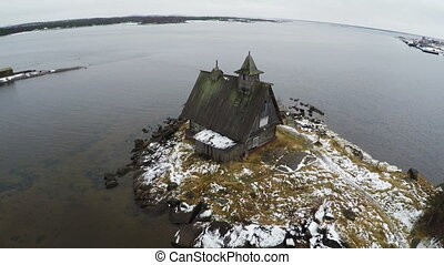 Flying over the township on coast in winter - Aerial winter...