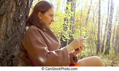 girl playing with phone in park