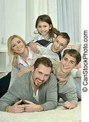 happy family at home - Portrait of a happy family at home