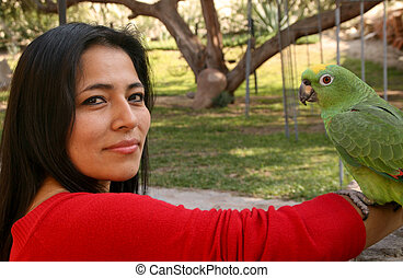 Attractive Latin Woman With A Parrot