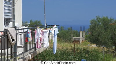 Clothes Drying on the Balcony after Washing - Wet clothes is...
