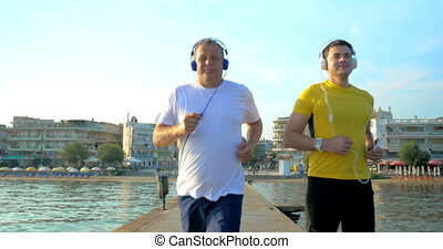 Man Checking Smart Watch during Morning Jogging - Steadicam...