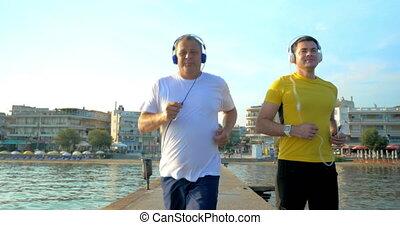 Man Checking Smart Watch during Morning Jogging