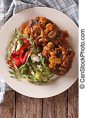 Salisbury steak with mushroom sauce and vegetable close-up...