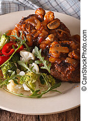 Salisbury steak with fresh vegetables close-up vertical -...