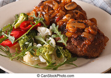Salisbury steak with fresh vegetables close-up Horizontal -...