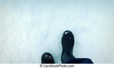 POV Boots Walking On Snow - POV looking down walking in...