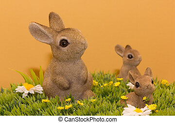 three bunnys - three brown bunnys on artficial grass