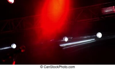 Bright stage lights flashing. Red and white lights with smoke.