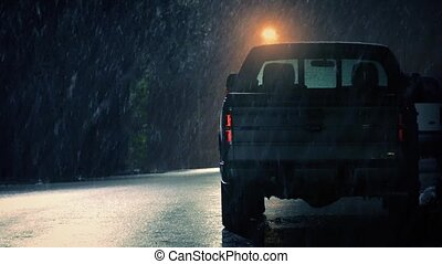Snow Falling On Parked Truck - Truck on side of road at...