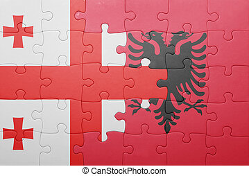 puzzle with the national flag of georgia and albania concept...