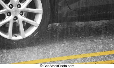 Closeup of Heavy Rain on a City Street - Closeup of heavy,...