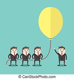 Business people holding balloon