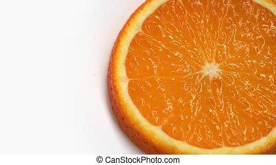 Orange fruit rotation on white background