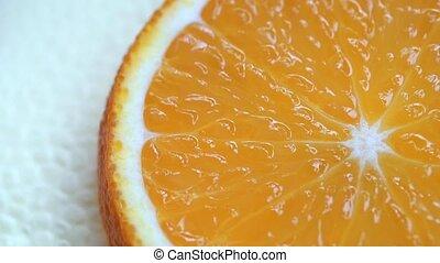 Slice of orange fruit rotation on white background